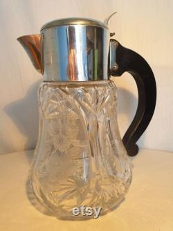 Beautiful heavy juice jug of beautifully cut crystal with engravings. Complete with cooler and strainer.