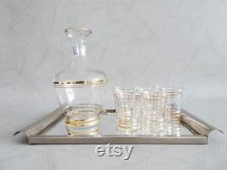 Glass carafe with glasses and mirror tray