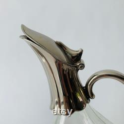 Heavily silver plated duckbill Decanter, with beautifully decorated glass.