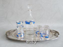 Italian glass carafe with glasses and silver plate