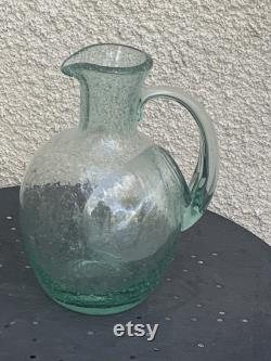 Large carafe, ice pitcher, cooler, in mint green blown glass, signed by vintage biot glassware.
