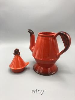 Mid century handmade orange ceramic coffee tea pitcher with a top cover 1970 s