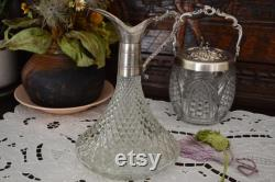 The ancient Ornate claret carafe, made of glass and silver metal. Vintage from the 1950s, very rare collection.