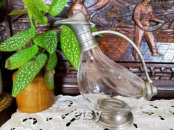 Traditional French carafe,Vintage glass pot. The lux container for wine, fruit juice or water. Vintage from the 1950s.